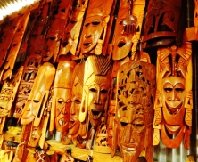A variety of African wooden masks on display. The emotions are clearly discernible.